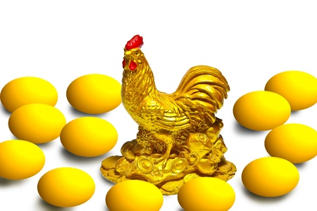Picture of golden chicken and egg on white background  photo