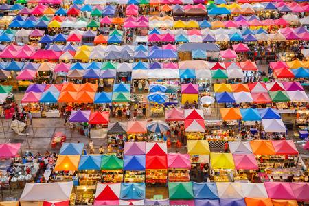 food shop: Colorful night market bird eye view  of Talad Rod Fai night market, Bangkok, Thailand.