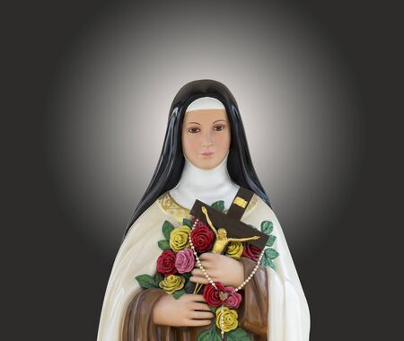 Virgin Mary statue with hands Holding roses and crucifix.