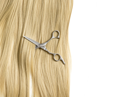 scissors to cut a lock of hair background blond hair 스톡 콘텐츠