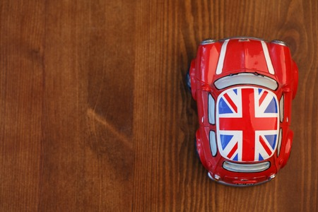 cooper: Red Mini Cooper model on wood background