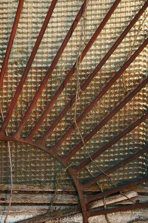 semicircular: Rusty semi-circular bars on window on the sunset