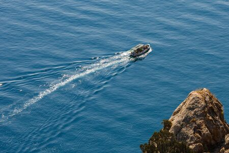 topdown: top-down view on the passenger boat floating along the shore Stock Photo