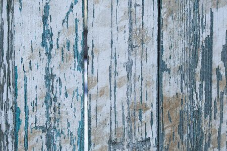 exfoliate: Old wooden painted light blue rustic background with cracked paint