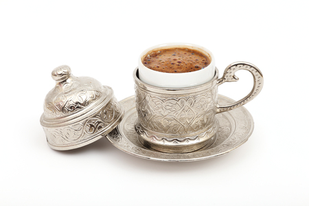 Turkish coffee in traditional silver cup on isolated white background Banque d'images
