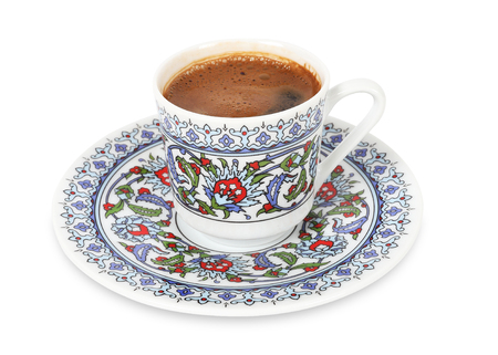 Turkish coffee in traditional porcelain cup on isolated white background Banque d'images