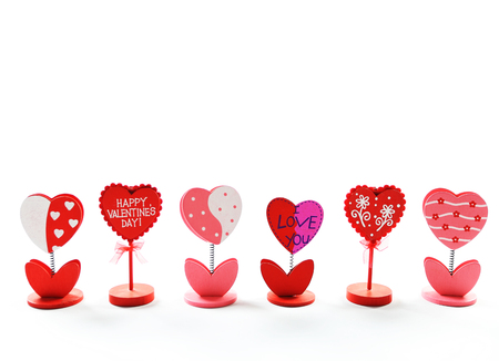 Heart shaped, happy Valentines Day note holder on isolated white background.