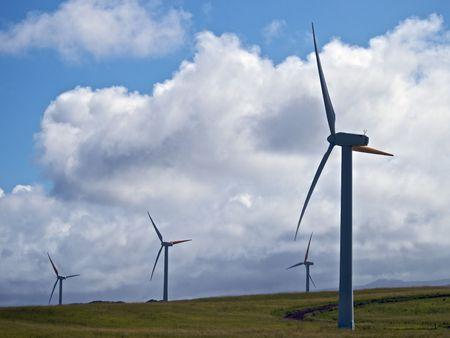 Windmills wait for a breeze on the big island of Hawaii Stock Photo