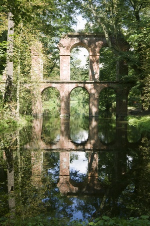 arkadia: The aqueduct in Arkadia park, Poland  Arkadia park is the known romantic English landscape garden in Poland   Stock Photo