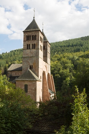 leger: The church of St  Leger in Murbach abbey in France  The monastery was founded in 727 as a Benedictine house  The Romanesque abbey church built of pink sandstone  It is dedicated to Saint Leger  Stock Photo