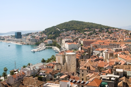 centred: Split cityscape in Croatia   Split is situated in the Mediterranean Basin on the eastern shores of the Adriatic Sea, centred around the ancient Roman Palace of the Emperor Diocletian and its bay and port
