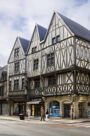 Three ancient half-timbered houses in Dijon, France  Dijon is a city in eastern France, capital of the Burgundy region