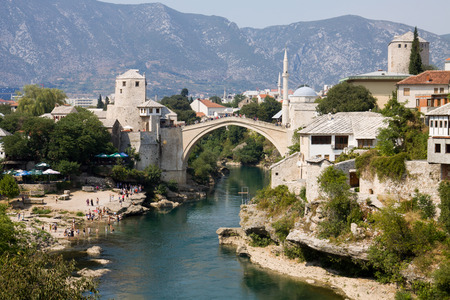 Mostar cityscape with Neretva river and the Old Bridge. Mostar is a city in Bosnia and Herzegovina.  photo