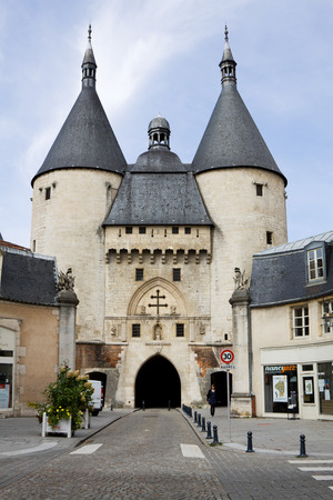 encircling: Craffe Gate in Nancy, France. The impressive Craffe Gate was built in the 14th century as part of the walls encircling the town. The large twin towers flanking the gate were added on in the 15th century and were used as prisons.