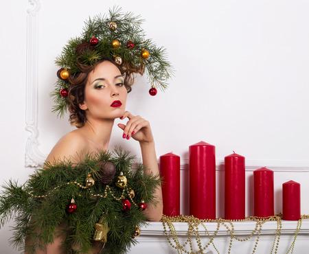 Christmas Woman. Beautiful New Year and Christmas Tree photo