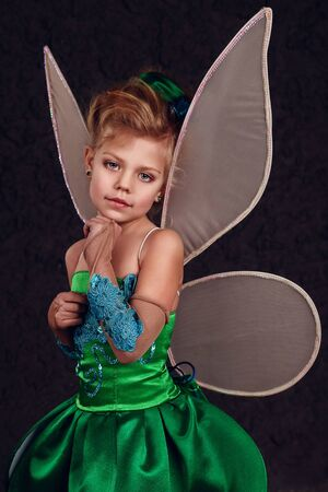 Tinker Bell. little girl dressed as a fairy tale of Peter Pan