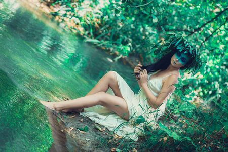 Young drown woman in a poetic representation.  The concept of the undead dark tales and legends Archivio Fotografico