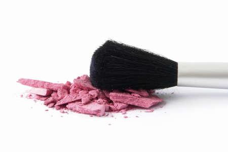 crushed by: Eyeshadow and Brush on white background Stock Photo