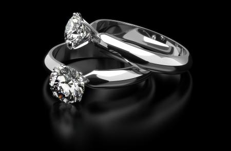 black diamond: Dos anillo de diamantes sobre fondo negro