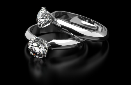 Two diamond ring on black background