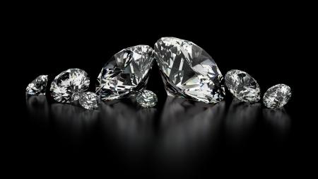 Ronde geslepen diamanten op zwart