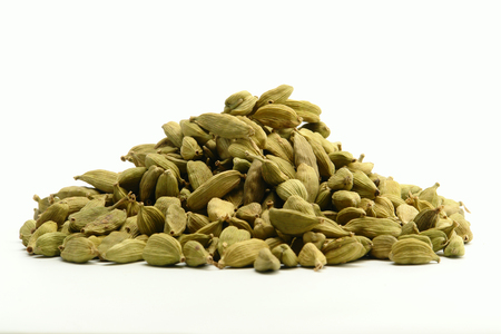 Green cardamom spice on white background