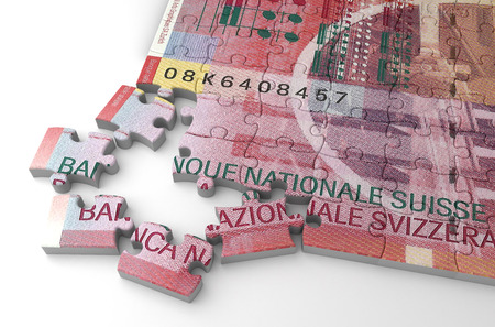 Swiss Franc Puzzle (isolated on white background) Stock Photo
