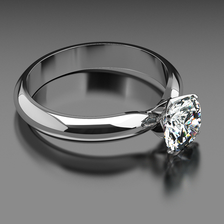 Solitaire ring on gray background