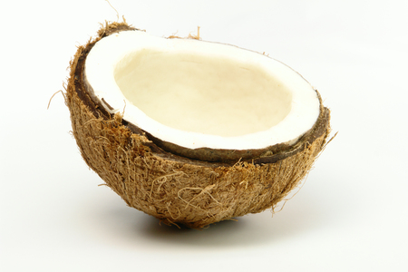 Fresh cracked coconut on white background