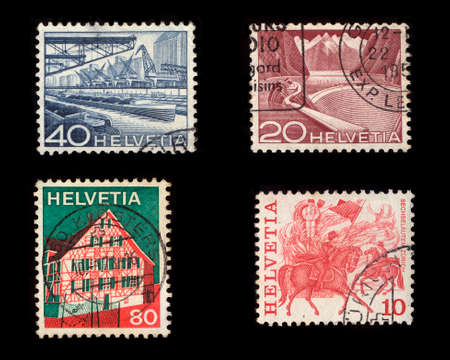 Helvetia Postage Stamps (Isolated on black background) Stock Photo