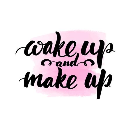 Inscripción de letras de pincel manuscrita inspiradora despierta y maquilla. Mancha de acuarela rosa sobre fondo.