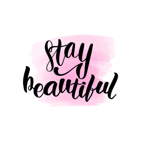 Inspirational handwritten brush lettering inscription stay beautiful. Pink watercolor stain on background.