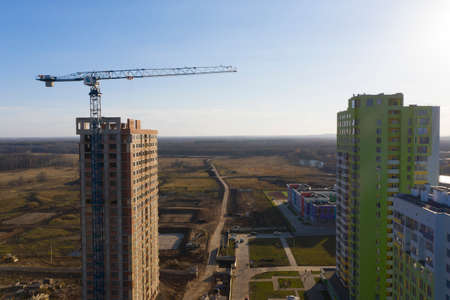 Tower crane at the construction site of a residential area Zdjęcie Seryjne