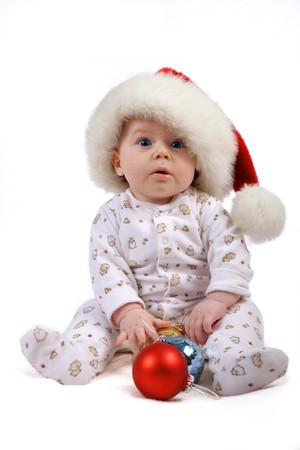 christmas child playing with Christmas decorations Stock Photo