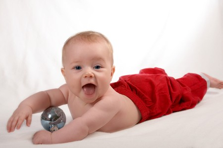 small Santa Baby isolated on white with toys Stock Photo