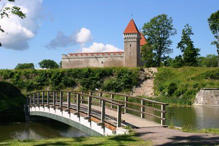 Castle and bridge through the river Stock Photo