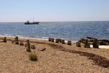 Old lonely boat in the sea in estonia Stock Photo - 4036437