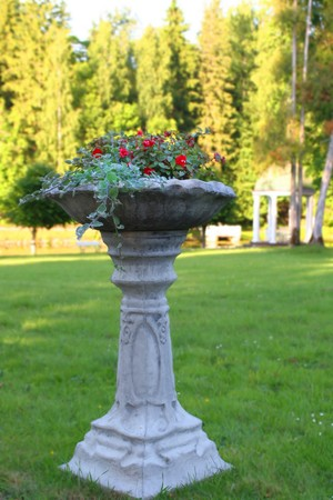 Ancient vase with flowers, in Palmse park photo