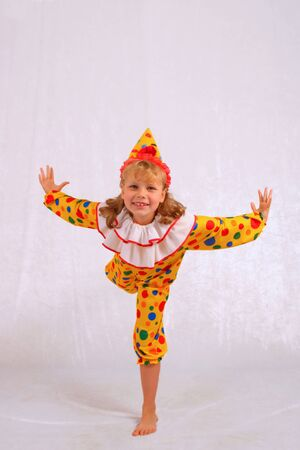 The girl in a fancy dress of the clown Stock Photo