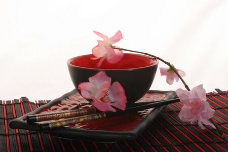 Chinese sticks, red plate and red cup Stock Photo