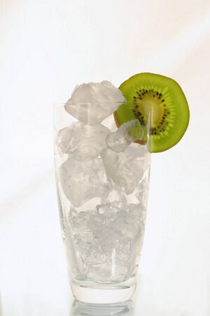 Cold icetea with cubes of ice and with a slice kivi