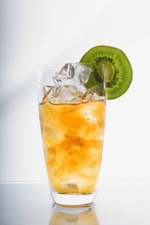 Cold icetea with cubes of ice and with a slice kivi photo