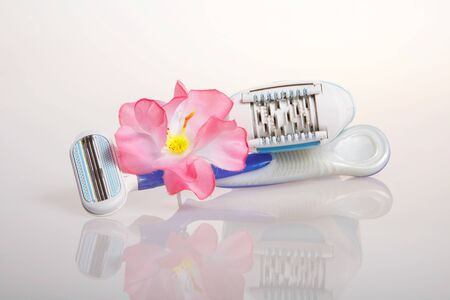 Blue safety razor and depilator photo
