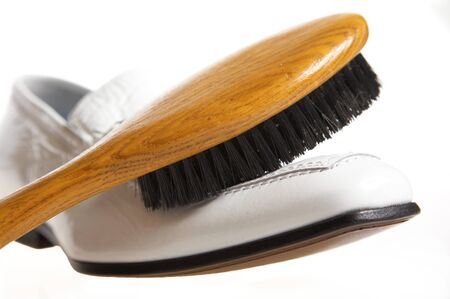 White shoe and brush for cleaning Stock Photo
