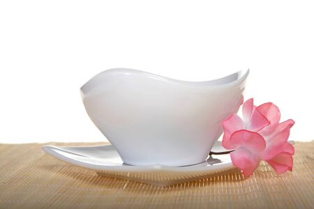 white pot and plate with flower