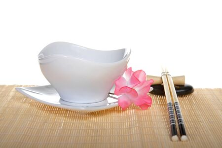 Sushi Place Setting: plate with chopsticks and flower Stock Photo