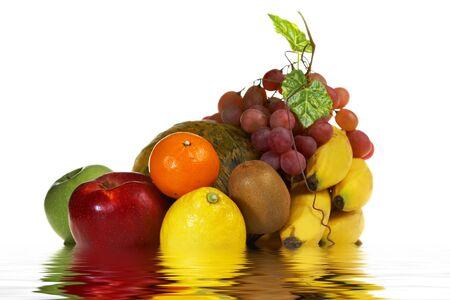 Juicy Fruits in water: banana, melon, apples, lemon, grapes, mandarin