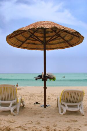 Sunchairs and umbrellas on beach in Phuket photo