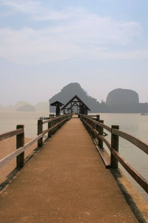Long wooden mooring in lagoon in Thailand photo