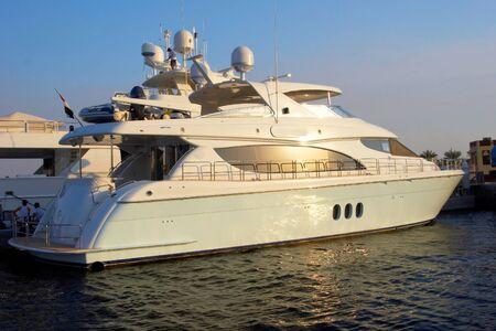 Mega big white yacht on a sunset